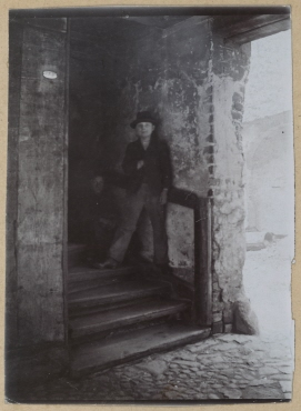 Staircase at the First Krögelhof With a Sitting and a Standing Boy
